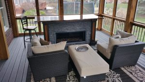 Gas powered fire place is the cherry on top of a great custom 3 seasons room