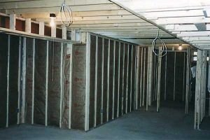Unfinished basement framing by Miles Bradley